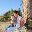 Mother and son goofing under a big pine tree — Stock Photo #7552739