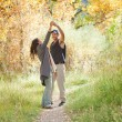 Young couple dancing in fall forest — Stock Photo
