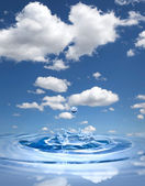 Water drop against blue sky — Stock Photo