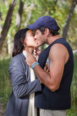 Happy young couple kissing — Stock Photo