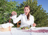 Woman spilling wine — Stock Photo