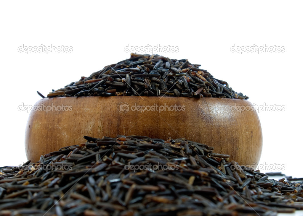 Wild rice in a wooden bowl isolated on a white background  Stock Photo #7553132