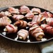 Mission figs wrapped in bacon - Stock Photo