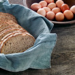 Fresh whole wheat bread and eggs — Stock Photo #7625640