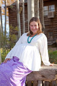 Pregnant woman in fall nature — Stock Photo