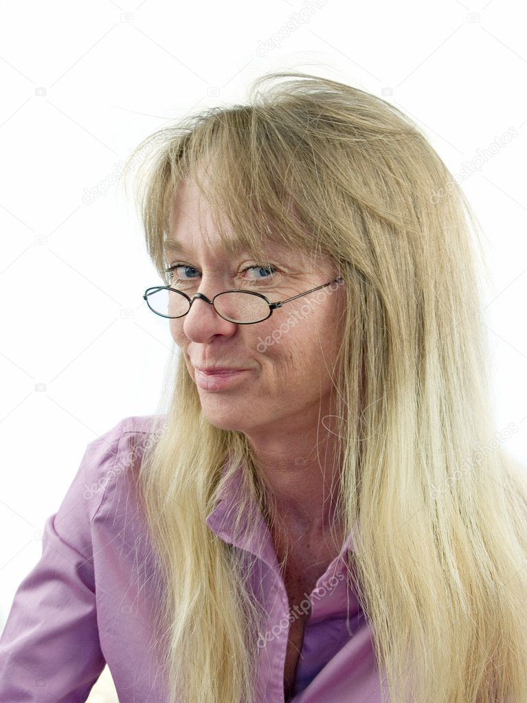 Average, smiley, slightly geeky blond woman in her early 40's  Stock Photo #7625583