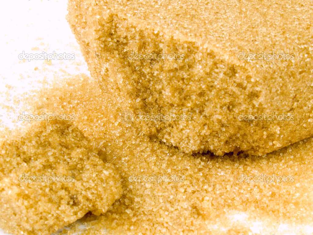Chunks and crystals of natural brown sugar on white — Stock Photo #7625645