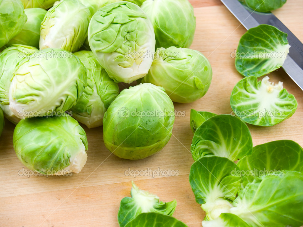 Fresh brussel sprouts on a wooden cutting board  Stock Photo #7625649