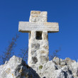 Stone Cross on the blue sky — Stock Photo
