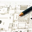 Stock Photo: Home plans with pencil
