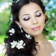 Beautiful bride in a blossoming garden — Photo