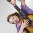 Beautiful girl who plays the guitar — Stock Photo #7476814