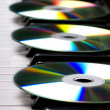 Cd-drive, lying on the piano keys — Stock Photo #7476871