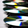 Cd-drive, lying on the piano keys — Stock Photo