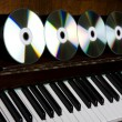Stock Photo: Cd-drive, lying on piano keys