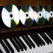 Cd-drive, lying on the piano keys — Stock Photo #7476880