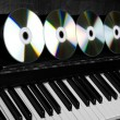 Cd-drive, lying on the piano keys — Stock Photo #7476885