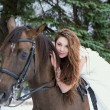 Girl in a white dress on a horse — Stok fotoğraf