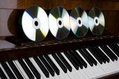 Cd-drive, lying on the piano keys — Stock Photo