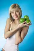Girl with a green apple — Stock Photo