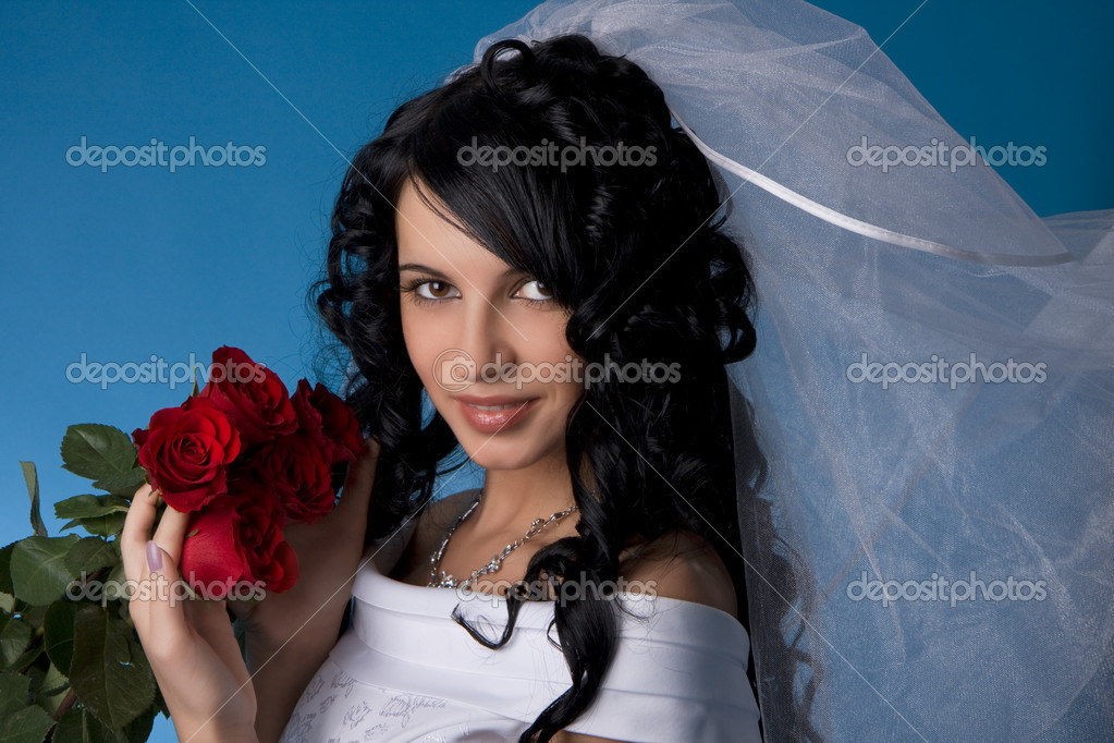 Image of the brunette bride with red roses on a blue background  Stock Photo #7476643