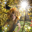 Beautiful girl on a background of trees and sun — Stock Photo