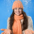 Beautiful brunette girl in the orange cap — Stock Photo