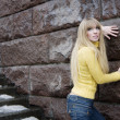 Stock Photo: Girl model next to a stone wall and stairs