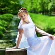 Curly bride against the backdrop of the stone ruins — Foto Stock