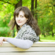 Stock Photo: Girl on park bench