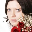 Beautiful brunette girl with a rose — Stock Photo