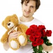 Man who gives bear and a bouquet of roses — Stock Photo