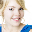 Smiling blond girl in blue — Stock Photo