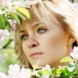 Beautiful girl in a flowering garden - 