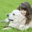 Girl with the golden retriever in the park — Stock Photo #7488672