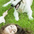 Girl with the golden retriever in the park — Stock Photo #7488674