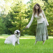 Stock Photo: Girl with golden retriever in park