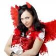 Girl in a devil costume with a gift — Stok fotoğraf