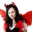 Foto Stock: Girl in devil costume with gift