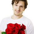 Beautiful man with a bouquet of roses — Stock Photo #7488725
