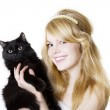 Blonde girl with a black cat — Stock Photo