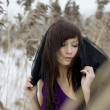 Beautiful brunette girl in reed — Stok Fotoğraf #7488912