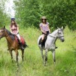 Girls ride horses in the park — Stock Photo #7488940