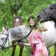 Brunette girl with horse — Stockfoto