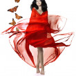Stock Photo: Girl in a red luxury