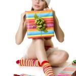 Santa girl with presents on white background — Stock Photo