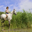 Brunette girl with horse — Stock fotografie #7489046