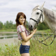 Brunette girl with horse — Stockfoto #7489066