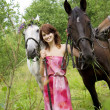 Brunette girl with horse — Stock Photo #7489074