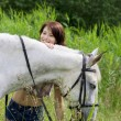 Brunette girl with horse — Photo #7489093
